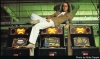 Tim Skelly lounges on some Reactor cabinets, circa 1982